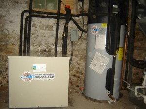 A new Earthlinked geothermal heat pump and a desuperheater water heater provide heat and hot water.