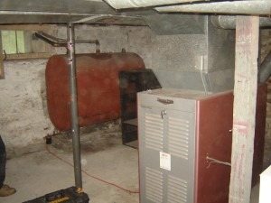 The existing heating system included an inefficient oil-fired furnace.