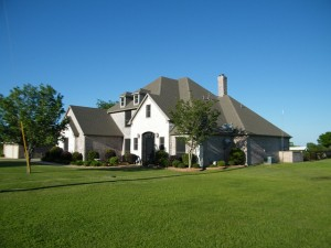 Home with large lawn area