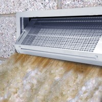 FEMA-approved flood vents like this  Smart Vent® model are designed to remain closed until a rising water level triggers an auto-opening mechanism. The open vent won't clog with debris like a screened vent.